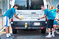 Brendan Kelly, '21, and Harrison Sailer,'21, scrub one of the Martin Luther King Center vans as they volunteers during the Salve Regina University Exploration Day in Newport.