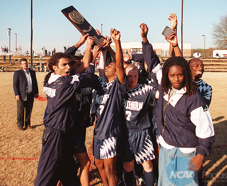 The Southern Connecticut State University team celebrates a 2-0 victory over the California State University Roadrunners at the Division II Mens Soccer Championship, December 3, 1995 in Spartanburg, SC. Thomas McCarver/NCAA Photos