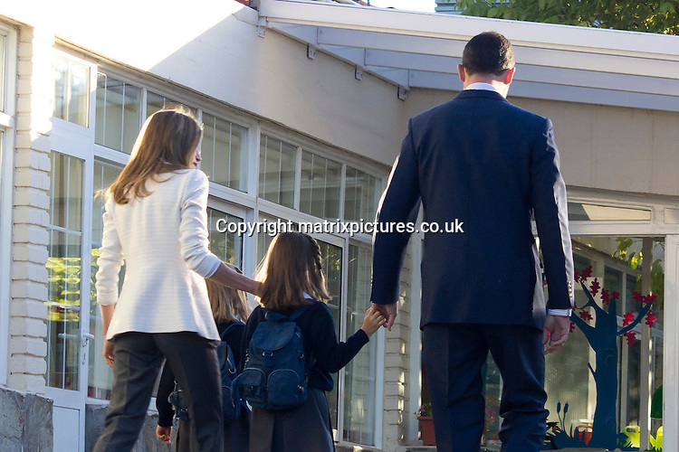 """NON EXCLUSIVE PICTURE: MATRIXPICTURES.CO.UK.PLEASE CREDIT ALL USES..UK, AUSTRALIA, NEW ZEALAND AND ASIA RIGHTS ONLY..Spanish royals Prince Felipe of Spain and his wife Princess Letizia of Spain are pictured dropping-off their daughters Leonor and Sofia for their first day at """"Santa Maria de los Rosales"""" school in Aravaca near Madrid, Spain...SEPTEMBER 14th 2012..REF: KDA 123858..KDN_EU"""