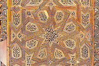 Fes, Morocco.  Medersa Bou Inania.  Carved Wooden Floral-Geometric  Decoration in Wall Panel.
