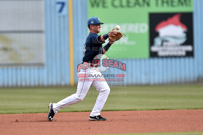 Asheville Tourists second baseman Forest Wall (7) throws to first during game one of a double header against the Greenville Drive on April 18, 2015 in Asheville, North Carolina. The Tourists defeated the Drive 2-1. (Tony Farlow/Four Seam Images)