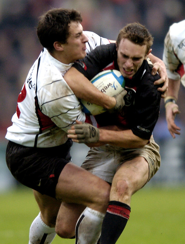 Photo: Richard Lane..Edinburgh Rugby v Stade Toulouse. Heineken Cup. 31/01/2003..Mike Blair is tackled by Yannick Jauzion.