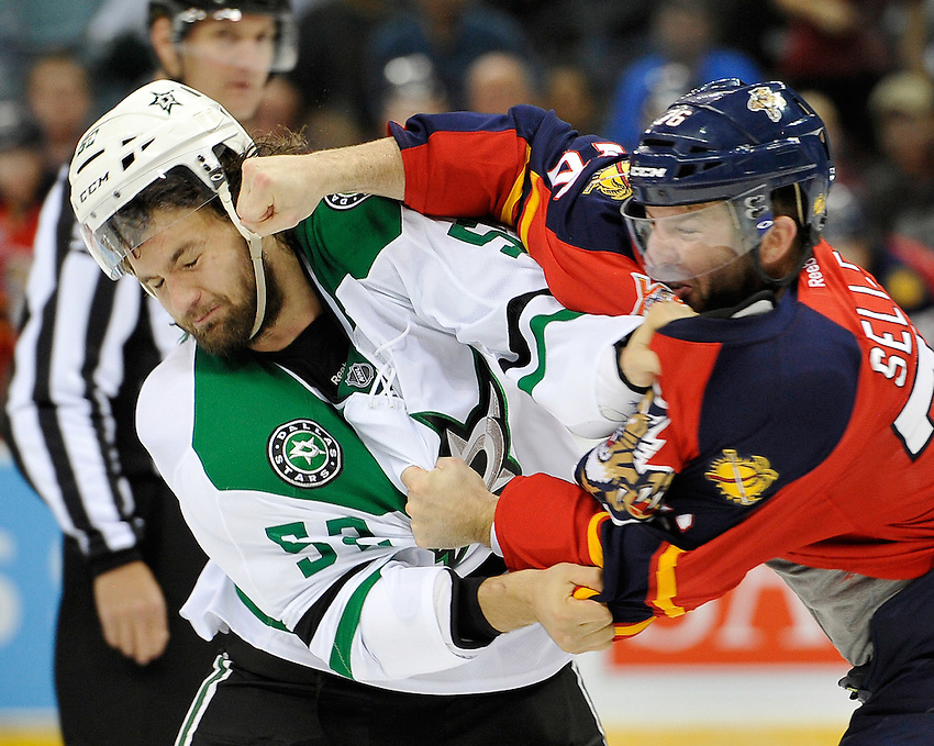 Dallas Stars' Luke Gazdic, left, and Florida Panthers' Eric Selleck fight during the first period of an NHL preseason hockey game between the Dallas Stars and the Florida Panthers, Friday, Sept. 20, 2013, in San Antonio, Texas. (Darren Abate/DA Media)