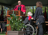 President Jonathan Veitch confers Recognition of Election to Emeritus Status to Professor Roger Boesche, with help from Roger's wife, Mandy.<br />