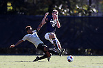 06 November 2016: Wake Forest's Jacori Hayes (8) tackles the ball away from Notre Dame's Brandon Aubrey (10). The Wake Forest University Demon Deacons hosted the University of Notre Dame Fighting Irish at Spry Stadium in Winston-Salem, North Carolina in a 2016 NCAA Division I Men's Soccer match and an Atlantic Coast Conference Men's Soccer Tournament quarterfinal. Wake Forest won the game 1-0.