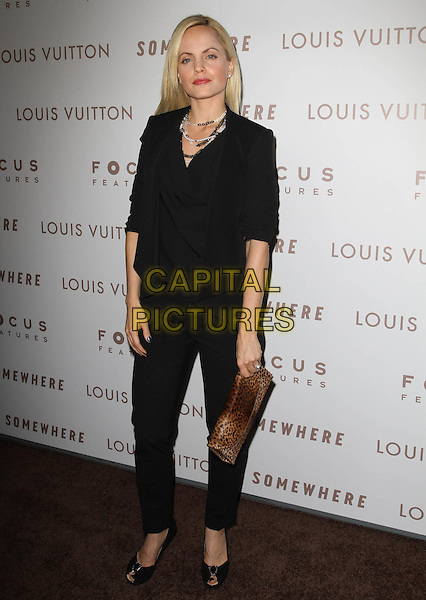 "MENA SUVARI.Premiere of ""Somewhere"" held At The Arclight Theatres, Hollywood, CA, USA..December 7th, 2010.full length black top jeans denim clutch bag brown leopard print .CAP/ADM/KB.©Kevan Brooks/AdMedia/Capital Pictures."