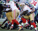 Seattle Seahawks linebacker Bobby Wagner (54) drags down San Francisco 49ers running back Frank Gore (21  at CenturyLink Field in Seattle, Washington on December 14, 2014. The Seahawks beat the San Francisco 49ers 17-7.