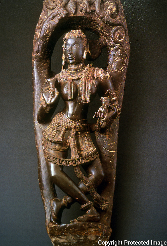 India:  A Celestial Cymbalist, c. 1100, Schist, 45 in. In Pratapaditya Pal, INDIAN SCULPTURE.  Words of praise in catalog, but nothing on religious affiliation or function.