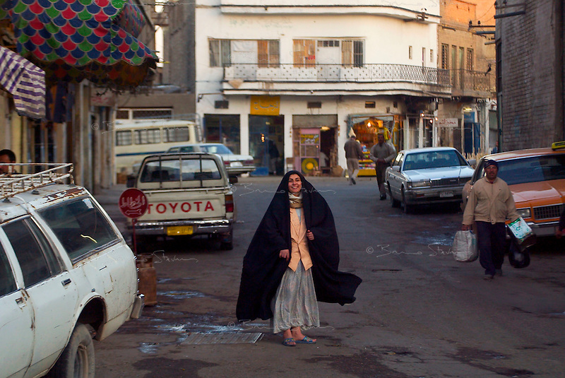 Baghdad, Iraq, Feb 14, 2003.Street scene at dusk.