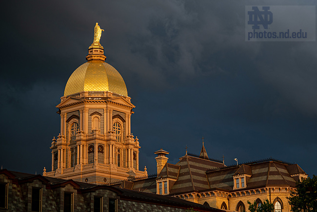 July 22, 2020; Sunset lights the Dome with storm clouds in the background (Photo by Matt Cashore/University of Notre Dame)