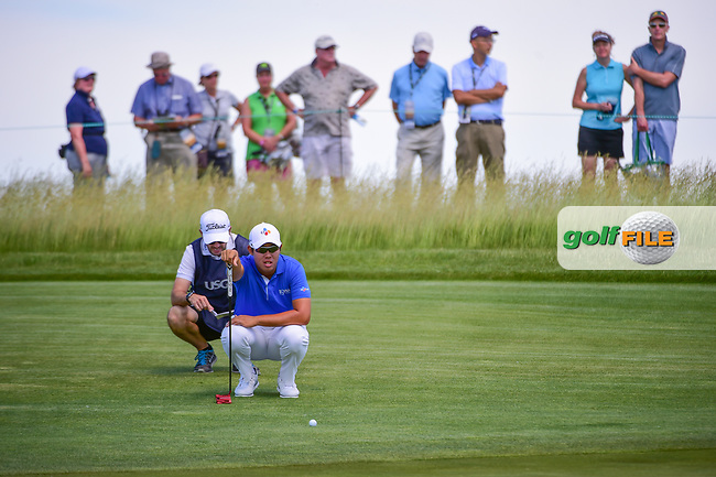 Byeong Hun An (KOR) looks over his putt on 11 during Thursday's round 1 of the 117th U.S. Open, at Erin Hills, Erin, Wisconsin. 6/15/2017.<br /> Picture: Golffile | Ken Murray<br /> <br /> <br /> All photo usage must carry mandatory copyright credit (&copy; Golffile | Ken Murray)