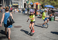 Young unicyclists practice prior to their 13-mile ride across the Brooklyn Bridge to Coney Island on Friday, August 29, 2014 as part of the NYC Unicycle Festival. The convergence of unicyclists was the start of the 3-day Fifth Annual New York City Unicycle Festival which besides the ride, features performances, classes and just plain fun with events happening on Governor's Island. (© Richard B. Levine)
