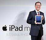November 30, 2012, Tokyo, Japan - President Koji Tanaka of KDDI, Japan's second largest communication carrier, shows off Apple's iPad mini with cellular connectivity in a count-down event at its studio in Tokyo on Friday, November 30, 2012. It is the first time for KDDI, the provider of the au mobile communication services, to offer the iPad series, Apple's popular line of multipurpose tablet computers. (Photo by AFLO) UUK -mis-