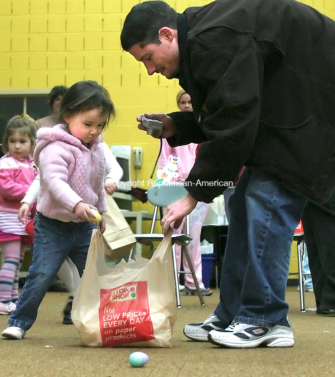 WINSTED, CT - 31 MARCH 2007 - 033107JW08.jpg -- Sierra Lesniak age 2 gets some help from her dad Dan Lesniak of Winsted during the Winsted Recreation Departments annual Easter Egg hunt Saturday morrning at Pearson Middle School.  Jonathan Wilcox Republican-American
