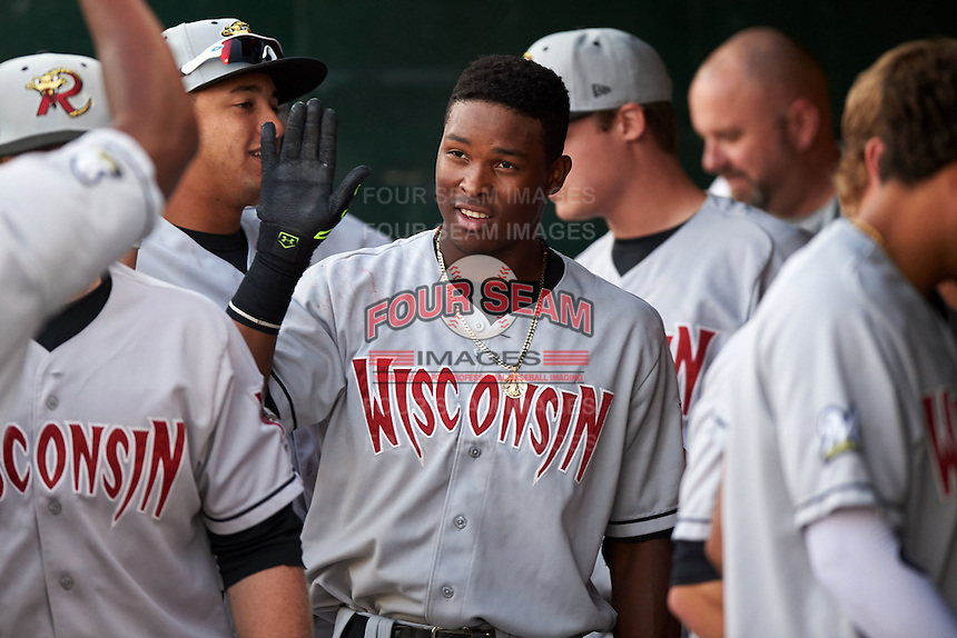 Wisconsin Timber Rattlers outfielder Luis Aviles (3) high fives teammates in the dugout after hitting a home run during a game against the Peoria Chiefs on August 21, 2015 at Dozer Park in Peoria, Illinois.  Wisconsin defeated Peoria 2-1.  (Mike Janes/Four Seam Images)