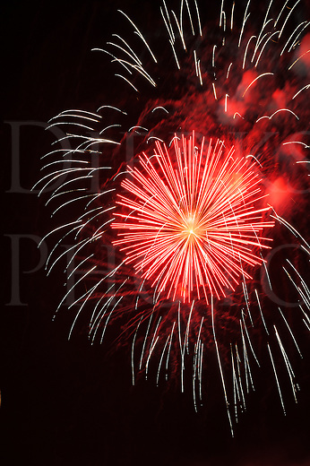 Fireworks red and white burst explosion against the night sky in holiday celebration, design elements and backgrounds.