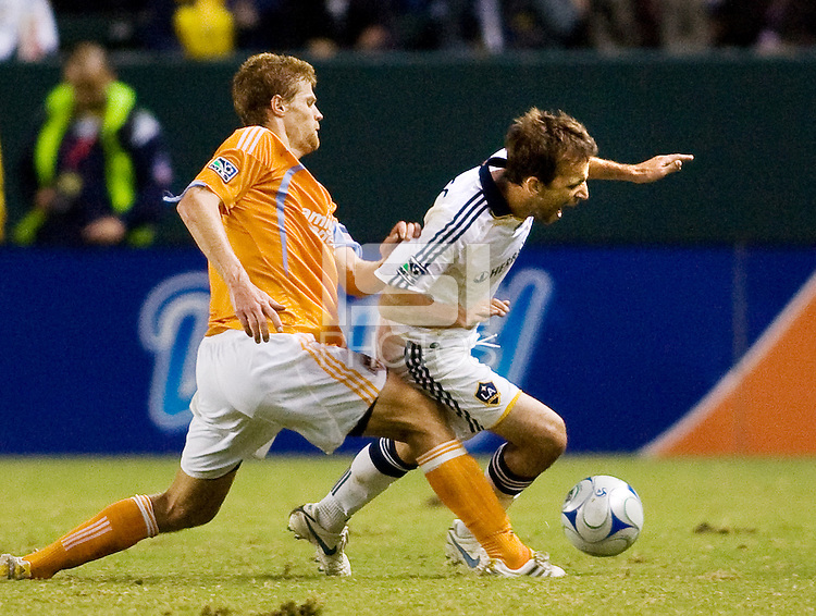 Houston Dynamo defender Andrew Hainault LA Galaxy forward Mike Magee battle head to head during the Western Conference Final. The LA Galaxy defeated the Houston Dynamo 2-1 to win the MLS Western Conference Final at Home Depot Center stadium in Carson, California on Friday November 13, 2009.....