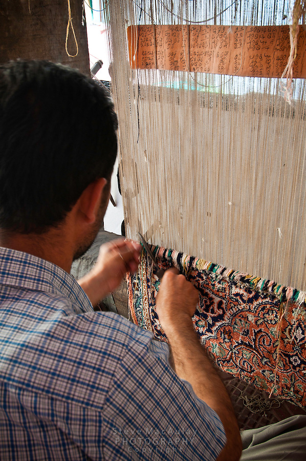 Kashmiri carpet maker at work on the complex pattern of knots that make up each  stunning piece, Srinagar, Kashmir, India.