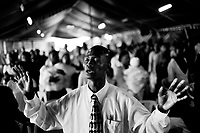 A worshipper in the Cathedral of Praise Ministry Church in Kibera.