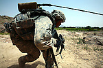 Spc. Tavon McAuley, 21, of Durham, N.C., a soldier with Company A, 2nd Battalion, 2nd Infantry Regiment ducks as his patrol is attacked by Taliban fighters near the village of Zangabad in Panjwayi district, Kandahar province, Afghanistan. April 27, 2009. DREW BROWN/STARS AND STRIPES