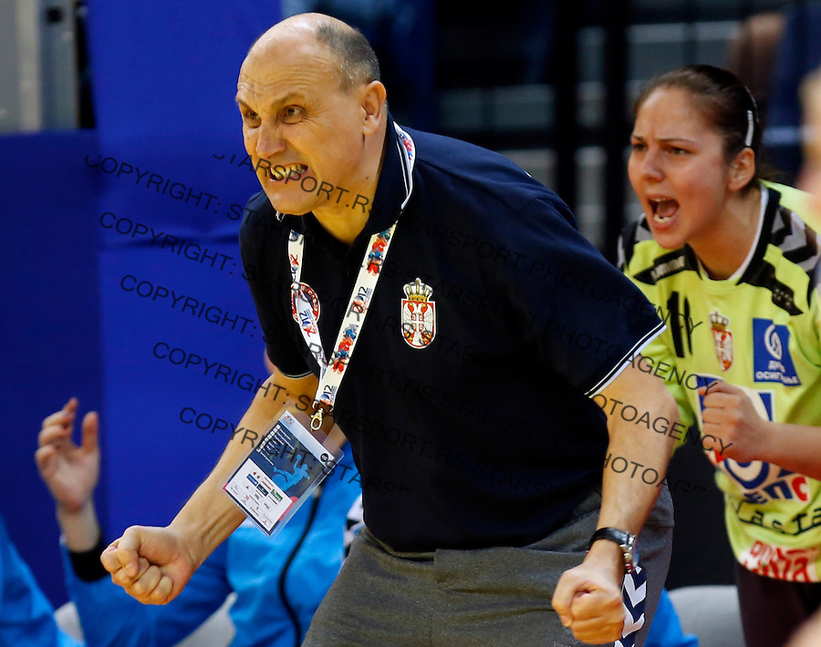 BELGRADE, SERBIA - DECEMBER 08: Head coach Sasa Boskovic (L) of Serbia reacts during the Women's European Handball Championship 2012 Group A match between Serbia and Czech Republic at Arena Hall on December 08, 2012 in Belgrade, Serbia. (Photo by Srdjan Stevanovic/Getty Images)