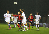 Vardan Bakalyan (left) and Ferid Matri compete for the aerial ball in the Armenia v Switzerland UEFA European Under-19 Championship Qualifying Round match at New Douglas Park, Hamilton on 11.10.12.