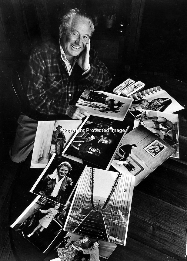 Life Magazine photographer Peter Stackpole at his Oakland home with some of his famous photographs. <br />