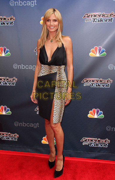 HOLLYWOOD, CA - APRIL 22: Heidi Klum attends NBC's 'America's Got Talent' Red Carpet Event at the Dolby Theatre on April 22, 2014 in Hollywood, California.  <br /> CAP/MPI/JO<br /> &copy;Janice Ogata/MediaPunch/Capital Pictures