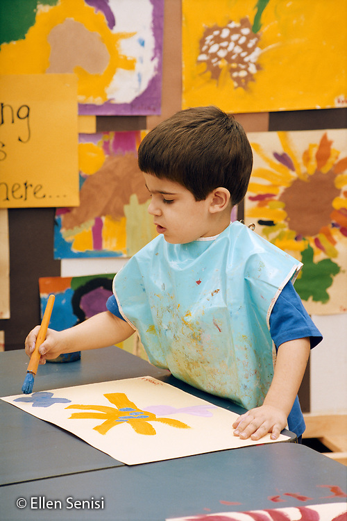 MR/Schenectady, New York.Yates Arts-in-Education Magnet School/ Full Day Pre-Kindergarten funded through New York State Pre-Kindergarten Program..Boy (5) paints picture of flower in arts-themed school..MR:Nic5.PN#: NG-AP12-R1-#19.scan from negative film.© Ellen B. Senisi