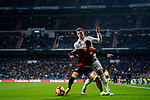 Roberto Roman Triguero, Tito L V, of Rayo Vallecano (R) competes for the ball with Toni Kroos of Real Madrid during the La Liga 2018-19 match between Real Madrid and Rayo Vallencano at Estadio Santiago Bernabeu on December 15 2018 in Madrid, Spain. Photo by Diego Souto / Power Sport Images