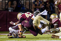 TALLAHASSEE, FLA. 9/5/15-Texas State University quarter Back Tyler Jones is brought down after a long run by Florida State University Lamarcus Brutus, center and Marquez White during first half action in the  vs.  football game at Doak Campbell Stadium in Tallahassee.<br /> <br /> COLIN HACKLEY PHOTO