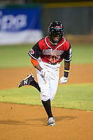 Eric Jenkins (5) of the Hickory Crawdads hustles towards third base against the Lexington Legends at L.P. Frans Stadium on April 29, 2016 in Hickory, North Carolina.  The Crawdads defeated the Legends 6-2.  (Brian Westerholt/Four Seam Images)