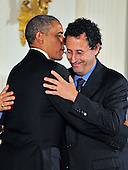Tony Kushner, right, hugs United States President Barack Obama, left, prior to accepting the 2012 National Medal of Arts during the presentation ceremony in the East Room of the White House in Washington, D.C. on Wednesday, July 10, 2013.<br /> Credit: Ron Sachs / CNP