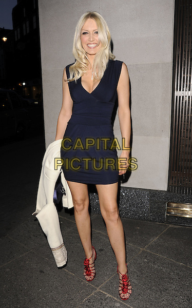 EMMA NOBLE.Nicky Haslam's book launch party, Westbury Hotel, London, England. .April 21st, 2010 .full length sleeveless black dress v-neck low cut cleavage red strappy ruffle shoes sandals navy blue.CAP/CAN.©Can Nguyen/Capital Pictures.
