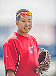 9 March 2013: Washington Nationals Medical Staff Assistant John Hsu tosses some ball prior to a Spring Training game against the Miami Marlins at Space Coast Stadium in Viera, Florida. The Nationals edged out the Marlins 8-7 in Grapefruit League play. Mandatory Credit: Ed Wolfstein Photo *** RAW (NEF) Image File Available ***