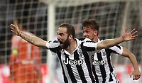 Calcio, Serie A: Inter - Juventus, Milano, stadio Giuseppe Meazza (San Siro), 28 aprile 2018.<br /> Juventus' Gonzalo Higuain celebrates after scoring during the Italian Serie A football match between Inter Milan and Juventus at Giuseppe Meazza (San Siro) stadium, April 28, 2018.<br /> UPDATE IMAGES PRESS/Isabella Bonotto