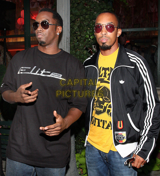 SEAN (DIDDY) COMBS & GUEST.At Estee Lauder's 'Give Breast Cancer the Pink Slip' Cocktail Party,.New York, 14th September 2005.half length sunglasses adidas top jacket black t-shirt.www.capitalpictures.com.sales@capitalpictures.com.© Capital Pictures.