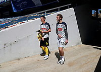 18th July 2020; The Kiyan Prince Foundation Stadium, London, England; English Championship Football, Queen Park Rangers versus Millwall; Shaun Williams and Goalkeeper Ryan Sandford of Millwall walking from the away tunnel onto the pitch before kick off