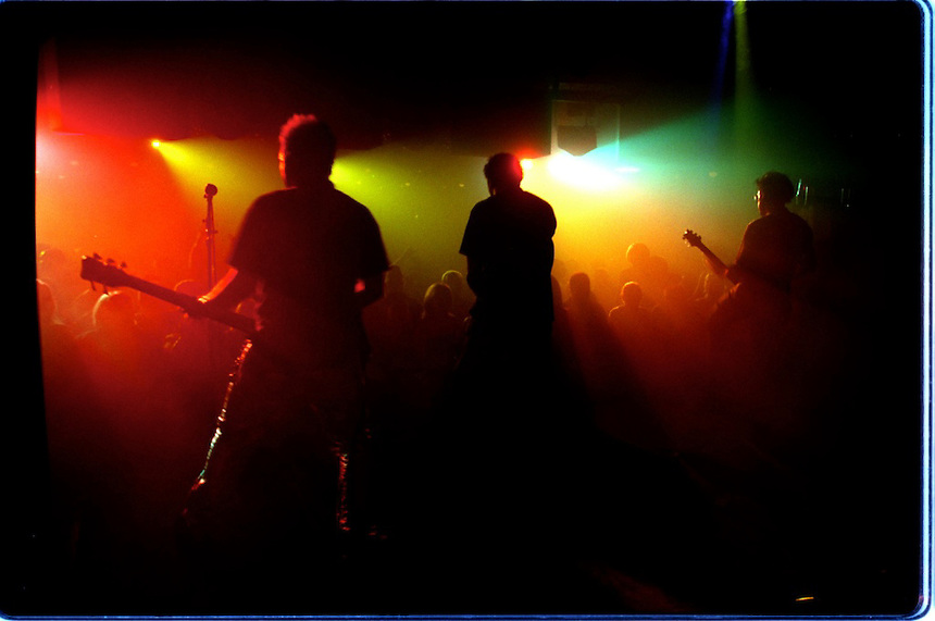 The Band Dial 7 takes the stage at the Boogie nightclub in Anaheim. (Left to right)Russell Barrett(bass), Mike Lord(vocals), and Chris Robosan(guitar) make up three of the 5 person alternative band.