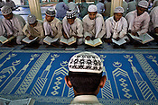 Religious muslim children are seen learning the Holy Quran by heart in Jamat-ul-Rashad Madrasa in Azamgarh, Uttar Pradesh, India. The Muslim youths are terrified and frightened. Police atrocities are on the rise against the muslim community. Teenagers and young men are picked up without warrants by the UP-ATS from villages of the district Azamgarh, the maligning of boys from a whole district as terrorists. These men may be picked up and implicated in false cases and confessions will be taken out of them through torture.