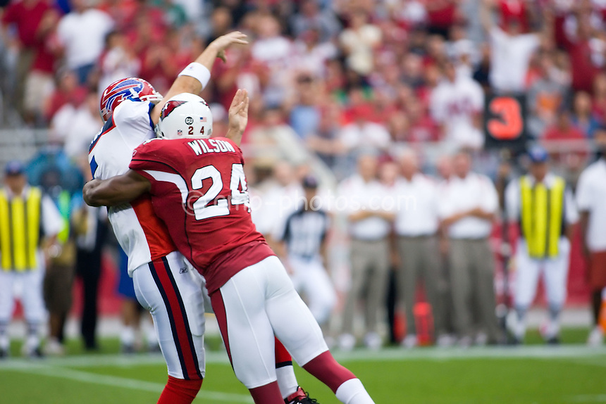 Oct 5, 2008; Glendale, AZ, USA; Buffalo Bills quarterback Trent Edwards (5) gets knocked out of the game by a hit from Arizona Cardinals safety Adrian Wilson (24) early in the first quarter of a game at University of Phoenix Stadium.