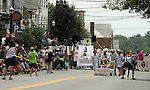 Overview of the start of the Pre-Race Parade preceeding The Great Saugerties Bed Race on Partition Street in Saugerties, NY on Saturday, August 6, 2011. Photo by Jim Peppler. Copyright Jim Peppler/2011.