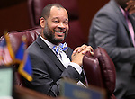Nevada Senate Minority Leader Aaron Ford, D-Las Vegas, works on the Senate floor at the Legislative Building in Carson City, Nev., on Tuesday, April 7, 2015. <br /> Photo by Cathleen Allison