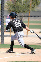 Andrew Wilkins #25 of the Chicago White Sox hits a homerun in a minor league spring training game against the Cleveland Indians at the White Sox complex on March 24, 2011 in Glendale, Arizona. .Photo by:  Bill Mitchell/Four Seam Images.