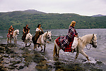 'CLAN, THE' SCOTLAND, A GROUP WHO SPEND THEIR WEEKENDS AT A CAMP IN GLEN CROE, RECREATING THE LIFE OF A SCOTTISH CLAN BEFORE THE DEFEAT OF BONNIE PRINCE CHARLIE AT THE BATTLE OF CULLODEN IN 1746. HONORARY MEMBER DIANE DAVIDSON LEADS THE CLAN ON A NINE MILE HORSE RIDE, HERE FORDING A RIVER. SHE & HER FATHER OWN 2000 ACRES OF GLEN CROE & THREE HILLS & LIVE IN A COTTAGE WITH NO ELECTRICITY. SHE SEES THE CLAN AS A 'PERFECT ANTIDOTE TO A GREY LIFE', 1989