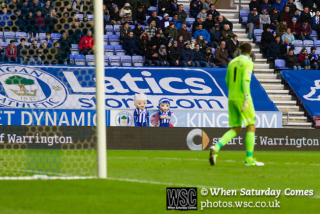 Wigan Athletic 1 Shrewsbury Town 0, 21/11/2015. DW Stadium, League One. The DW Stadium. Wigan Athletic earned a narrow 1-0 at home to Shrewsbury Town. Wigan competed in the Premier League from 2005 to 2013. They won the 2013 FA Cup. The club also embarked on its first European campaign during the 2013–14 UEFA Europa League. Pheonix and Blue, the Wigan mascots standing in front of an advertising banner for the Wigan online shop.  Photo by Paul Thompson