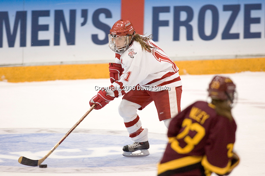 MINNEAPOLIS, MN - MARCH 26: Sharon Cole #11 of the Wisconsin Badgers women's hockey handles the puck against the Minnesota Golden Gophers at Mariucci Arena during the Women's Frozen Four Tournament final on March 26, 2006 in Minneapolis, Minnesota. The Badgers beat the Gophers 3-0. (Photo by David Stluka)