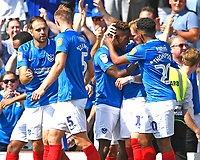 Jamal Lowe of Portsmouth third right is mobbed after scoring the first goal during Portsmouth vs Luton Town, Sky Bet EFL League 1 Football at Fratton Park on 4th August 2018