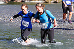NELSON LAKES, NEW ZEALAND - APRIL 18:  Laura Hay and Emma Carrington cross the Travers River during the 2015 Alpine Lodge Loop The Lake trail run at Lake Rotoiti on April 18 16, 2015 in Nelson, New Zealand. (Photo by Marc Palmano/Shuttersport Limited)