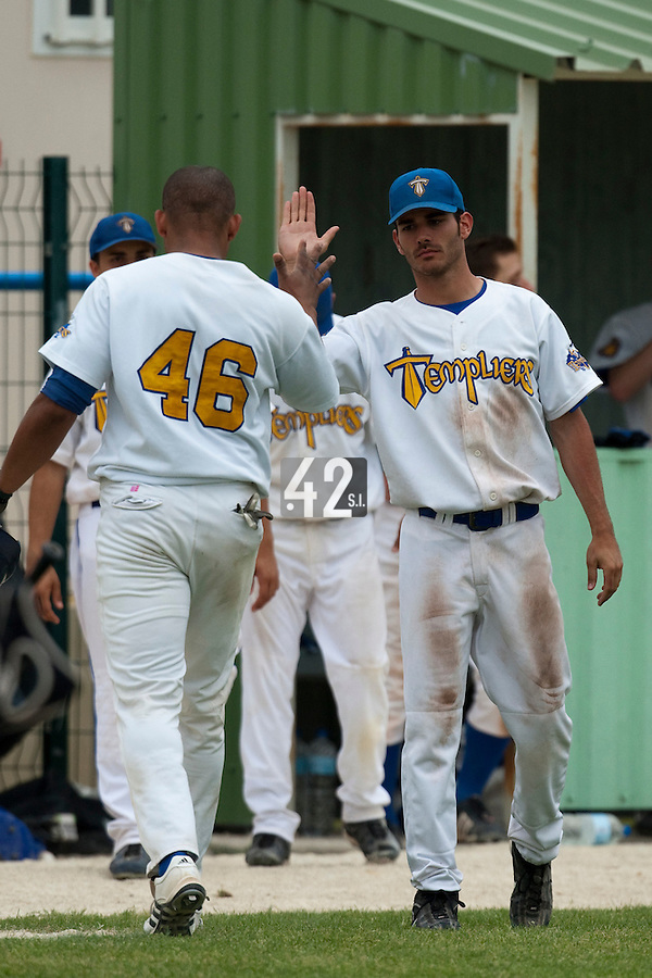 22 May 2009: Ernesto Martinez of Senart is congratulated by Julien Brelle Andrade during the 2009 challenge de France, a tournament with the best French baseball teams - all eight elite league clubs - to determine a spot in the European Cup next year, at Montpellier, France.